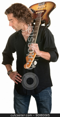 Serious Guitarist Looks Down stock photo, Handsome man looking away with guitar over white background by Scott Griessel