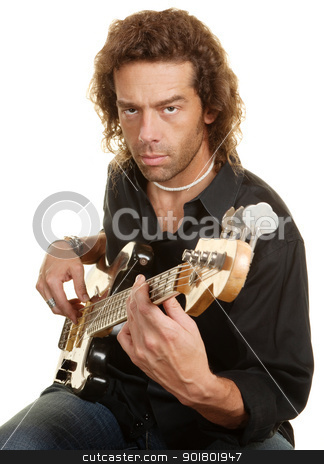 Serious Guitar Player stock photo, Serious man strumming his guitar over white background by Scott Griessel