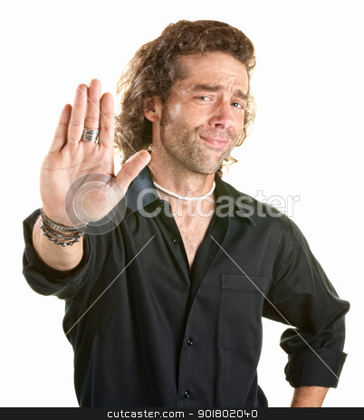 Man Gestures Stop stock photo, Handsome young man with palm facing forward by Scott Griessel