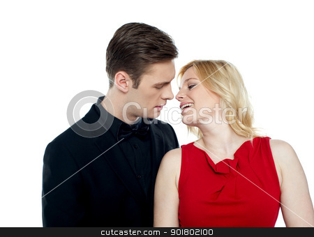 Happy couple kissing each other stock photo, Happy couple kissing each other in front of camera by Ishay Botbol
