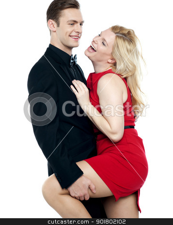 Lets make some love stock photo, Lets make some love. Young caucasian couple having fun by Ishay Botbol