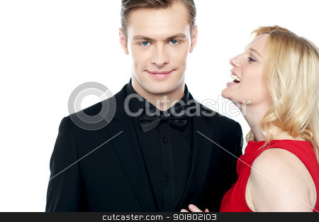Woman whispering something to her sweetheart stock photo, Woman whispering something to her sweetheart on white background by Ishay Botbol   