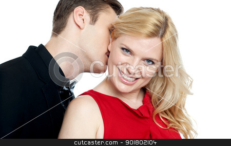 Closeup of young man kissing his lovers neck stock photo, Closeup of young man kissing his lovers neck. All on white background by Ishay Botbol   