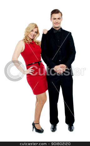 Attractive couple posing in party wear dress stock photo, Attractive couple posing in party wear dress. Full length portrait by Ishay Botbol