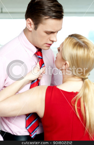 Female secretary forcing boss to love her stock photo, Female secretary forcing boss to love her. Holding him from tie by Ishay Botbol