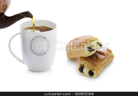 pouring tea with pain au chocolat stock photo, pouring tea into a cup with pain au chocolat by Lee Avison