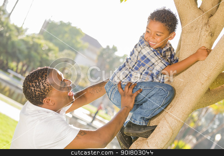 Happy Mixed Race Father Helping Son Climb a Tree stock photo, Happy Mixed Race Father Helping Son Climb a Tree in the Park. by Andy Dean