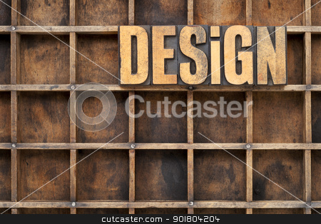 design concept in wood type stock photo, design word in vintage letterpress wood type against divider pattern of a grunge typesetter case by Marek Uliasz