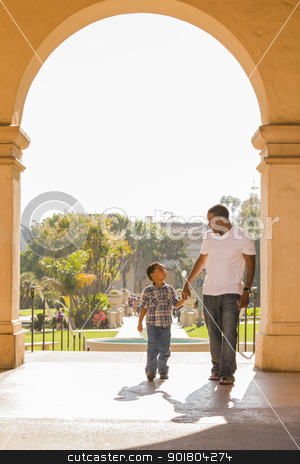 Mixed Race Father and Son Walking in the Park stock photo, Happy African American Father and Mixed Race Son Holding Hands Walking in the Park. by Andy Dean