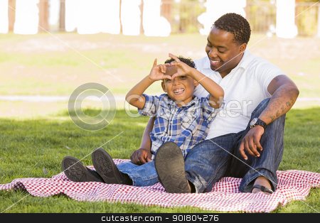 Mixed Race Father and Son Making Heart Hand Sign stock photo, Happy African American Father and Mixed Race Son Making Heart Hand Sign at the Park. by Andy Dean