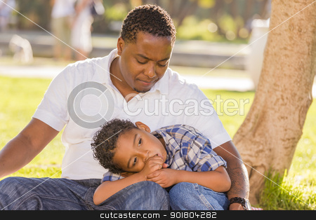 African American Father Worried About His Mixed Race Son stock photo, African American Father Worried About His Mixed Race Son as They Sit in the Park. by Andy Dean