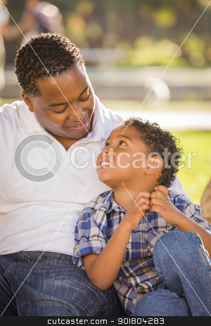 Happy Mixed Race Father and Son Playing stock photo, Happy African American Father and Mixed Race Son Playing in the Park. by Andy Dean