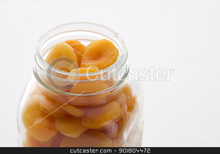 jar of dried apricot stock photo, dried apricot in a glass jar by Yann Poirier