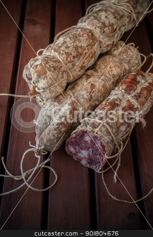 Salami stock photo, Seasoned taste sausage on the wood table by Giordano Aita