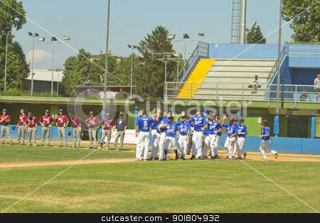 Baseball game stock photo, NOVARA, ITALY - JULY 7: Baseball game Novara (blue)-Bologna (purple) 1-17, Italian Serie A. Novara team walks on the field. July 7, 2012 by Fabio Alcini
