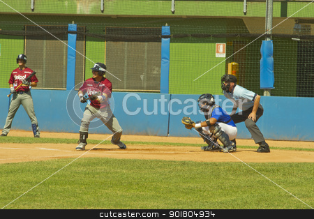 Baseball game stock photo, NOVARA, ITALY - JULY 7: Baseball game Novara (blue)-Bologna (purple) 1-17, Italian Serie A. Bologna shortstop Juan Carlos Infante tries a bunt. July 7, 2012 by Fabio Alcini