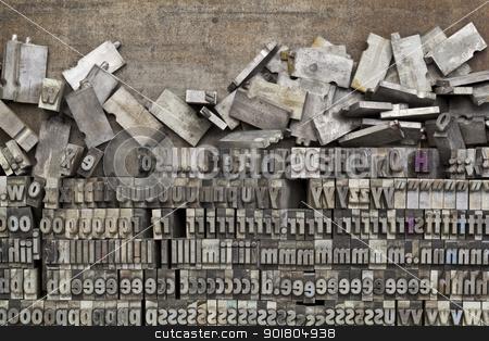 metal letterpress printing blocks stock photo, disorganized vintage grunge metal letterpress printing blocks on a tray by Marek Uliasz