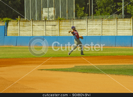 Baseball game stock photo, NOVARA, ITALY - JULY 7: Baseball game Novara (blue)-Bologna (purple) 1-17, Italian Serie A. Bologna right fielder Claudio Liverziani throws the ball. July 7, 2012 by Fabio Alcini