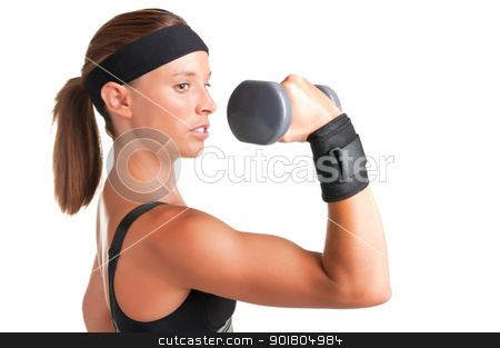 Woman Working Out stock photo, Woman working out with dumbbells at a gym by ruigsantos