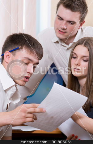 Happy young business woman with male  stock photo, Happy young business woman with male colleagues reviewing document in meeting by Vadim