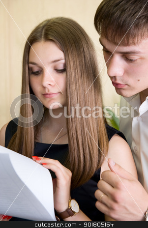 Two businessmen working with documents stock photo, Two businessmen working with documents. by Vadim