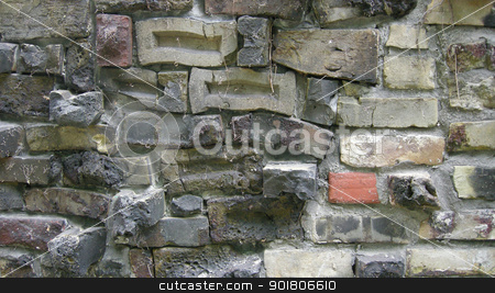Brickwork stock photo, An aging wall made of brick, with plenty of texture and character; some dried ivy stems remain attached to the brick face. by Maria Bell