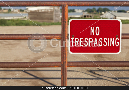 no trespassing sign stock photo, red no trespassing sign on an iron gate with out of focus farm building behind by Marek Uliasz