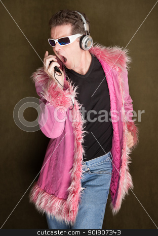 Singing Out Loud stock photo, Man dancing in pink fluffy coat singing loudly by Scott Griessel