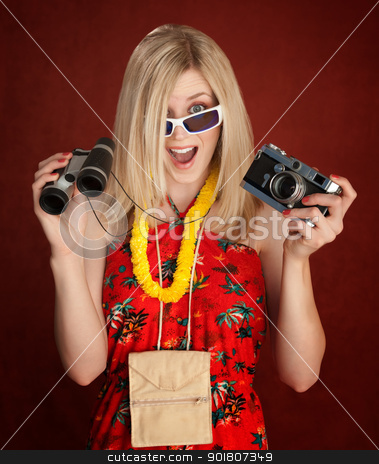 Excited Tourist stock photo, Excited Female Tourist with Camera and Binoculars Dressed for a Luau by Scott Griessel