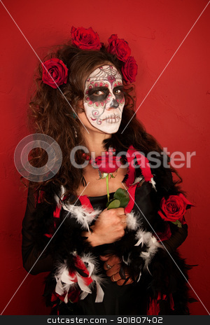 Women With Roses for Dia De Los Muertos stock photo, A Pretty Middle Aged Lady With Roses and Wearing Makeup for All Souls Day by Scott Griessel