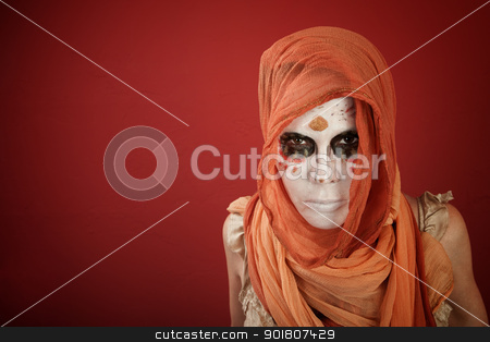 All Souls Day stock photo, A woman with headscarf wearing makeup for All Souls Day by Scott Griessel