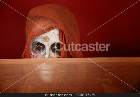Woman dressed for Day of the Dead stock photo, Woman with makeup for Day of the Dead and a scarf in front of her mouth. by Scott Griessel