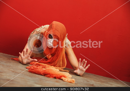 Crazy Day of the Dead Lady stock photo, Lady with Day of the Dead makeup on the ground bowing in submission by Scott Griessel