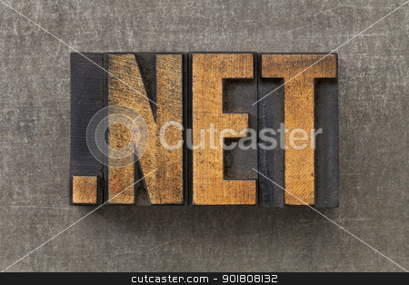 network internet domain  stock photo, dot net   - inetwork nternet domain in vintage wooden letterpress printing blocks on a grunge metal sheet by Marek Uliasz