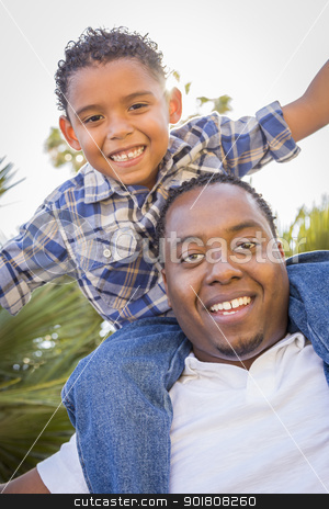 Mixed Race Father and Son Playing Piggyback in Park stock photo, Happy African American Father and Mixed Race Son Playing Piggyback in the Park. by Andy Dean