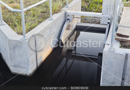 irrigation ditch gate stock photo, remotely controlled gate of irrigation ditch in Colorado farmland by Marek Uliasz