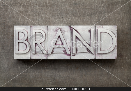brand word in metal type stock photo, brand word in vintage letterpress metal type against a grunge steel sheet by Marek Uliasz