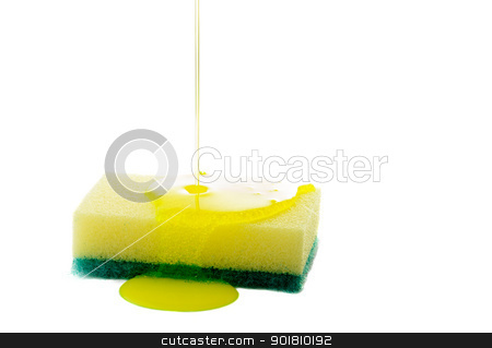 Sponge stock photo, Liquid soap being poured on a dish sponge. by Richard Nelson