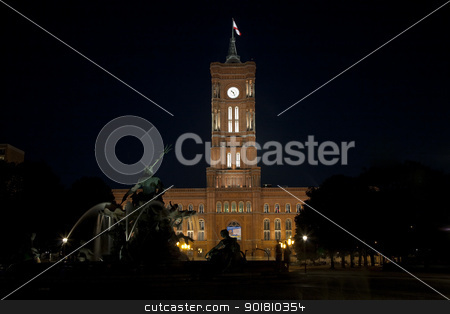Berlin Town Hall (Rotes Rathaus) - Germany stock photo, The Berlin Town Hall (Rotes Rathaus) in Germany with the silhouette of the Neptune fountain in the foreground. by Chris Dorney
