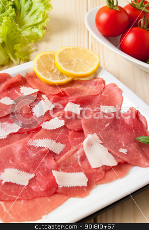 Carpaccio stock photo, Dish of carpaccio beef with parmesan cheese and lemon by Giordano Aita