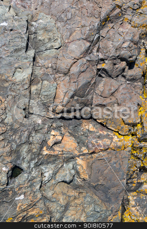 Natural granite rock texture worn by the sea. stock photo, Natural granite rock texture worn by the sea. by Stephen Rees