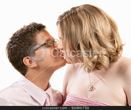 Kissing Girlfriends stock photo, Kissing female couple close up over white by Scott Griessel