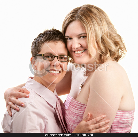 Friends Hugging stock photo, Two happy friends embrace over white background by Scott Griessel