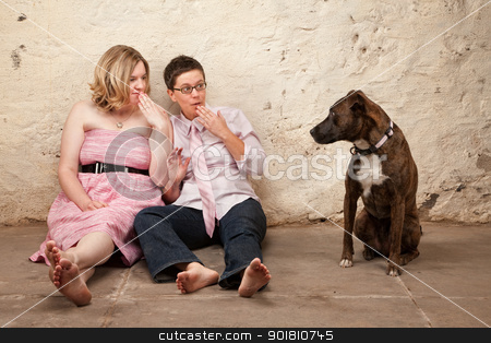 Surprised Women With Dog stock photo, Two surprised ladies on the floor with pet dog by Scott Griessel
