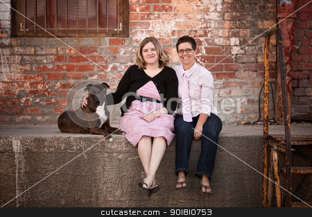 Best Friends with Pet Dog stock photo, Smiling female friends with dog on old loading dock by Scott Griessel
