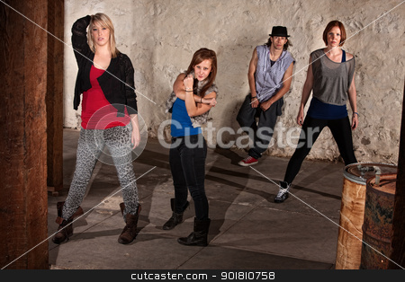 Young Hip Hop Dancers stock photo, Four young break dancers posing in underground setting by Scott Griessel