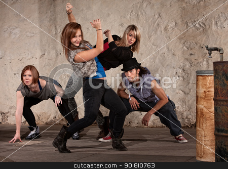 Pretty Dancer with Hip Hop Group stock photo, Pretty European woman dancing with Hip Hop group by Scott Griessel