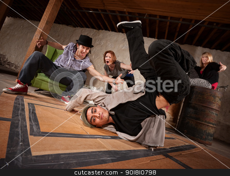 Break Dancer Backspin stock photo, Handsome Hispanic male break dancer spinning on back by Scott Griessel