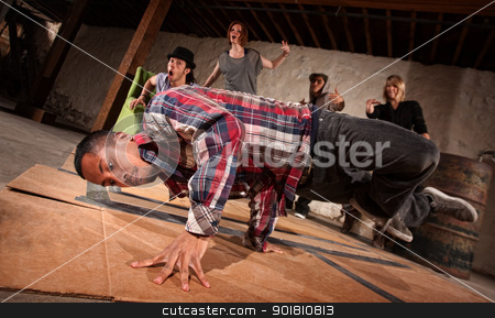 Man Spins on Hand stock photo, Group of people cheers on break dancer performing by Scott Griessel