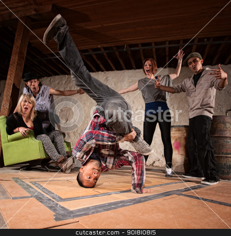 Break Dancing Headspin stock photo, Latino man spinning on his head in break dancing battle by Scott Griessel